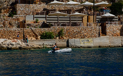 Fetch the water (Rupert Brun) Tags: 2017 greece holiday ionian island ithaca mediterranean september summer kioni gr woman rib boat tender water