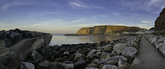 Harbour wall (EricMakPhotography) Tags: sunrise staithes harbour water sea red reflection sky ray