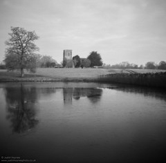 Church of St. Mary the Virgin #2 (Justin Haynes Photography) Tags: wwwjustinhaynesphotocouk midlands bigwaters water england winter church gb greatbritain reflections noon landscape lake nature film monochrome mono unitedkingdom manfrotto tripod trees britain ilfordpanf fawsleyhall tree northamptonshire analog pinhole 6x6 europe uk 120