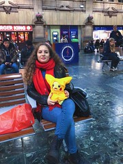 KOWD1013 (idefleunam) Tags: uk scotland edinburgh station train pikachu peluche toy red scarf girl hair curly blonde smile people evening christmas bag