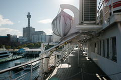 from the old ship deck (kasa51) Tags: ship deck city tower hikawamaru yokohama japan 氷川丸 甲板 横浜マリンタワー light shadow lifeboat 救命ボート cityscape