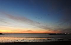 Newbiggin Bay -  January Morning Sunrise (Gilli8888) Tags: newbigginbythesea newbiggin northeast coast seaside northumberland sunrise shoreline seascape sun sky rocks beach turbines northsea nikon p900 coolpix silhouette silhouettephotography windturbines bay january panorama