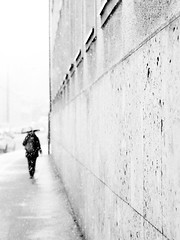 winter walk (Sandy...J) Tags: walking white walk winter olympus street streetphotography sw schwarzweis strasenfotografie stadt silhouette city urban umbrella monochrom mono blackwhite bw germany deutschland blur blurred fassade fading snowfall