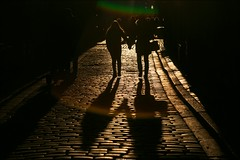 Hand in hand (*Kicki*) Tags: stockholm gamlastan sweden oldtown fotofikapromenad autumn people silhouettes shadows candid street cobblestone handinhand backlight sunlight ffp flare city backlit explore explored