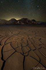 Night time on the mud flats (Hilary Bralove) Tags: mudcracks landscape nikon stars nightphotography deathvalley california deathvalleynationalpark