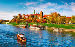 Wawel castle famous landmark in Krakow Poland. Picturesque landscape on coast river Wisla. Autumn su (Bob Morrow) Tags: ageold ancient antique architecture autumn autumnal bank boat castle city cloud coast cutter europe european evening fall famous floating grass grassy krakow landmark landscape lawn motorboat nature old panorama picturesque plot poland polish river scenic sky sun sunlight sunset sunshine swimming town transport water wawel wisla yellow