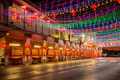 Colors and lights of Chanthaburi Street during Chinese New Year. (baddoguy) Tags: backgrounds beauty building exterior built structure celebration event chinese culture new year city street cityscape color image copy space cultures curtain decoration diminishing perspective empty glittering hanging happiness holiday horizontal land vehicle lantern festival local landmark long exposure luck market stall multi colored years eve night no people outdoors photography speed thai thailand travel destinations urban road vibrant wall feature window