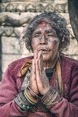Unswerving Faith (Roberto Pazzi Photography) Tags: asia nepal bhaktapur people portrait street photography place culture one person head shoulders woman elderly nepali ethnicity outdoor wrinkles glance face closeup old eyes nikon buddhist buddhism hands pray religion