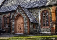 church courtyard (jsleighton) Tags: church courtyard door red stain glass windows grass slate