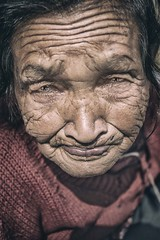 Humility (Roberto Pazzi Photography) Tags: asia nepal kathmandu people portrait street photography place culture one person head shoulders woman elderly nepali ethnicity outdoor wrinkles glance face closeup old smile cap eyes nikon happyplanet asiafavorites