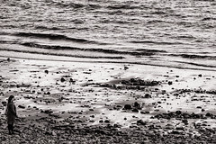 Looking out to sea (raymorgan4) Tags: penarth beach seashore sand rocks waves woman lady solitary figure alone gazing seascape xt20 fujifilm acros black white monochrome south wales bristol channel coast welsh