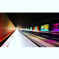 Lux snowy night (joannab_photos) Tags: colorful snow night bridge tram longexposure