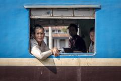 Portrait in Hopin Railway Station, Kachin State (Daddi Andrea) Tags: myanmar burma burmese birmania asia southeastasia asian asean travel street streetphotography tourism portrait train railway window blue people