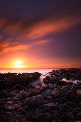 Setting sun (Rico the noob) Tags: dof rock d850 landscape sunset 20mm water outdoor stones clouds longexposure sky beach ocean published travel sun rocks coast tenerife 2018 teneriffa 20mmf18 sea nature