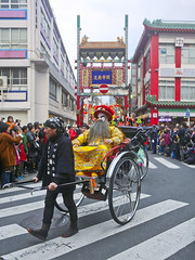 Lunar New Year parade in Yokohama Chinatown (DigiPub) Tags: 终身制 倒退 复辟 定于一尊 假装是 皇上 皇帝 阴历年 春节 过年 四旧 横滨中华街 横浜中華街 正月 旧暦新年 パレード 関帝廟通り 春節 陰曆年 橫濱中華街 遊行 1130552684 istockbygettyimages 299043787 2019 adult adultsonly annualevent artscultureandentertainment blurredmotion buildingfeature builtstructure celebration celebrationevent cheerful chinatown chineseculture chineseethnicity chinesenewyear costume day emperor enjoyment entertainmentevent event facepaint famousplace fulllength fun gate groupofpeople happiness humaninterest japan kanagawaprefecture largegroupofpeople men motion onlymen outdoors parade people performance performer photography rickshaw rickshawdriver roadsign spectator street traditionalclothing traveldestinations vertical yokohamachinatown zebracrossing