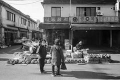 Market (OzGFK) Tags: 35mm asia korea nikkor nikon rollei100 seoul analog blackandwhite bw film monochrome nikonf3t market shopping