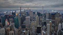 NYC - Twilight - Crepúsculo   # 052 (ricardocarmonafdez) Tags: nyc midtownmanhattan newyork cityscape ciudad city edficios rascacielos skyscraper sky skyline cielo nubes clouds rainyday grayday lighting lights shadows arquitectura architecture ricardocarmonafdez ricardojcf nikon d850 24120f4gvr ocaso atardecer sunset twilight