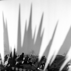 ... (johnny walker no label) Tags: bw street film120 mediumformat mamiyac220 people reflections bazaar kodaktx400