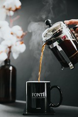 person pouring tea on black ceramic mug - Credit to https://myfriendscoffee.com/ (John Beans) Tags: coffee coffeebean coffeeshop cafe coffeebeans shopbeans espresso coffeecup cup drink