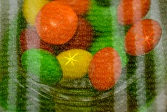 Skittles & Towel (Double Exposure) (deanrr) Tags: doubleexposure redux macromondays december312018utc towel dishtowel yellow green orange candy glass cloth stripes macro starburst red colors texture