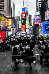 TimesSquare-Chatting amongst the Colour (wes_f_hunt) Tags: candid buildings shops photography lights street new york times square colour black white theatre district broadway fuji x xe2 big apple billboards nyc manhattan midtown