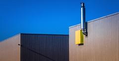Factory Facades 1 (rob kraay) Tags: aluminumbuilding flatroof chimney robkraay outdoorlightning roofedge bluesky shadow
