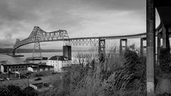 (el zopilote) Tags: 700 600 500 astoria oregon oregoncoast smalltowns street townscapes cityscape architecture landscape industrial ships bridges astoriamelgerbridge rivers columbiariver water clouds pano panorama lumix gf1 milc m43 lumixgvario1442mmf3556asphmegaois bw bn nb blancoynegro blackandwhite noiretblanc bwdigital bndigital schwarzweiss monochrome