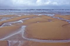 croyde bay (Ron Layters) Tags: sand beach lowtide croydebay sea waves coast horizon ripples pools water breakingwaves patterns texture winter northdevon croyde barnstaple devon england unitedkingdom slidefilmthenscanned slide transparency fujichrome velvia leicar6 leica r6 ronlayters