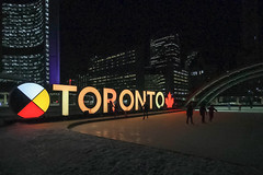 Toronto sign turns gold to celebrate Drake's Grammy award (A Great Capture) Tags: share3dto xoto drake gold toronto torontosign cityhall nathanphillipssquare agreatcapture agc wwwagreatcapturecom adjm ash2276 ashleylduffus ald mobilejay jamesmitchell torontoexplore on ontario canada canadian photographer northamerica winter l'hiver 2019 ice icerink skatingrink rink colors colours efs1018mm 10mm wideangle city downtown lights urban night dark nighttime cold snow weather colourful colorful cityscape urbanscape eos digital dslr lens canon 70d outdoor outdoors outside vibrant cheerful vivid bright streetphotography streetscape photography streetphoto street calle neige schnee