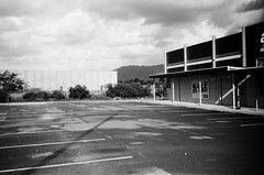 Parking lot (Matthew Paul Argall) Tags: kodakstar500af 35mmfilm blackandwhite blackandwhitefilm ilforddelta100 100isofilm parkinglot urban