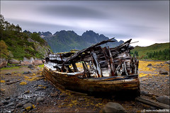 Sildpolltjønna Ship Wreck Lofoten Norway (Stefan Bock) Tags: lofoten norway norwegen landscape landschaft travel reise natur nature nopeople traveldestinations beautyinnature sildpollnes longexposure langzeitbelichtung water sky clouds rocks mountains himmel bewölkt sildpolltjønna ship shipwreck abandoned schiff schiffswrack verlassen