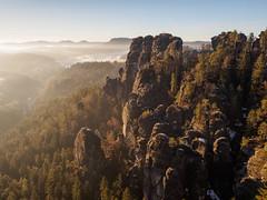 Rocks of Saxon Switzerland (wiscmic) Tags: lohmen sachsen deutschland de olympus sunrise landschaft nature felsen germany natur rocks em1 elbsandsteingebirge saxon bastei landscape sächsischeschweiz elbsandstein saxonswitzerland nationalpark omd