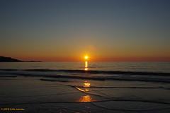 3KB07490a_C (Kernowfile) Tags: pentax cornwall cornish stives porthmeorbeach sand water ripples reflections reflectedlight reflectionsinwater sun sunlight sky starburst rocks cliffs