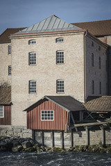 Old Powerhouse in Stenkullen, Sweden (Adam Dahlberg) Tags: sony a6000 alpha sweden outdoors nature blue sky building powerhouse old architecture stonehouse stone house woodhouse river spring summer sunny sun ilce6000 kit lens 50mm