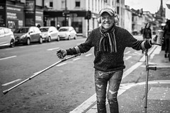 The Crutch (Leanne Boulton) Tags: internationaldayofhappiness urban street candid portrait portraiture streetphotography candidstreetphotography candidportrait streetportrait eyecontact| candideyecontact streetlife stpatricksday man male face expression emotion mood feeling happiness happy grimace dancing dance crutches cap action alcohol drink tone texture detail depthoffield bokeh naturallight outdoor light shade city scene human life living humanity society culture lifestyle people canon canon5dmkiii 70mm ef2470mmf28liiusm black white blackwhite bw mono blackandwhite monochrome glasgow scotland uk