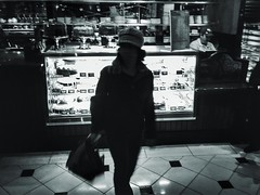 (Luther Roseman Dease, II) Tags: dessert monochrome skancheli lowkey light darkened contrejour streetphotography street noireetblanc silhouette atlanta cheesecake woman hat bag glass lone human element public candid atmosphere chiaroscuro framing depth form fotografie narrative