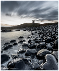 Black Shinny Things (Steven Peachey) Tags: northeastcoast northeastengland northumberland ef1740mmf4l canon5dmarkiv leefilters lee09gnd longexposure dunstanburghcastle rocks seascape beach explored explore