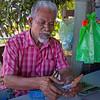 Cashier (zol m) Tags: shopkeeper man x100t fujifilm zolsimpression zolmuhd