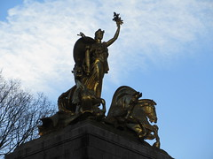 2019 Victory Statue USS Maine Monument - Gold Leaf Gilded 2318 (Brechtbug) Tags: uss maine monument 1913 beaux arts commemorate controversial sinking battleship 1898 the ship has sculpted representations mythological figures victory peace courage fortitude justice central park entrance nyc 02192019 new york city arms wrapping around rock statue sculpture february 2019 columbus circle