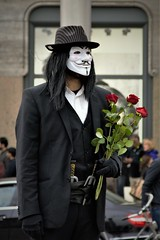 Flowers for...... (NBD Photography) Tags: amsterdam holland netherlands performer street flowers hat mime mask vandetta anonymous mystery face strange costume