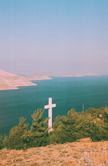0072-0300-19 (jimbonzo079) Tags: cross saint agios savvas monastery sea view seascape water tree hill above kalymnos κάλυμνοσ island dodecanese 2018 land landscape aegean greece mountain canon ae1 fd 135mm f25 lens trip travel world europe analog film 35mm 135 color colour art vintage old hellas ελλάσ ελλάδα summer vacation konica minolta vx100 super expired canonae1 fd135mmf25 konicaminoltavx100super konicavx100 konicaminoltavx konicaminoltavx100 expiredfilm