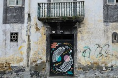 Your door, my canvas (halifaxlight) Tags: portugal azores saomiguel pontadelgada building door windows balcony graffiti art neglect urban colourful painting