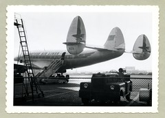 """Lockheed L-749A Constellation (Vintage Cars & People) Tags: vintage classic black white """"blackwhite"""" sw photo foto photography airtravel aviation lockheed constellation connie 1950s fifties newark newarkairport newarkmetropolitanairport baggagecarriertrain eastern easternairlines mobilestairway boardingramps aircraftsteps airstairs n121a"""