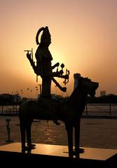 Kolkata sunset (draskd) Tags: silhouette sunset goddess durga madurga statue kolkata india light figure armed good hindu religion colal10 smartphonephotography lion celestial silhouettes