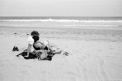 summer at the beach, Sydney 2019  #232 (lynnb's snaps) Tags: 35mm ilfordhp5 longreef pentaxmz5 pentaxm28mmf35 xtol bw beach couples film love ocean reading relaxing surf surfers waves longreefbeach slr 2019 sydney australia coast summer romantic boy girl man woman sand