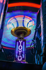 yo-yo squeeze (pbo31) Tags: bayarea eastbay alamedacounty california nikon d810 color night dark black march 2019 boury pbo31 oakland butleramusements fair traveling carnival spinning lightstream motion ride midway depthoffield truck cab