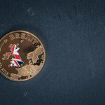 Brexit coin on a black background thumbnail