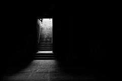 The way up (dharder9475) Tags: 2015 5star bw blackandwhite dark entrance glowing light privpublic stairs underchicagoseries up