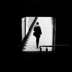 Done For The Day (Sean Batten) Tags: london england unitedkingdom gb bank underground londonunderground light shadow person candid walking city urban blackandwhite bw streetphotography street