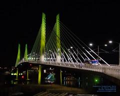 TRIMET BUS STARTING TO CROSS THE TILLIKUM CROSSING AT NIGHT (AvgeekJoe) Tags: bridgeofthepeople d5300 dslr nikon nikond5300 oregon portland tamron18400mm tamron18400mmf3563diiivchld tilikumcrossing tilikumcrossingbridgeofthepeople willametteriver bridge cablestayedbridge night nightphoto nightphotograph nightphotography nightshot transitbridge